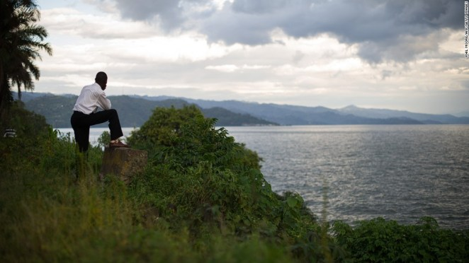 A man looks out toward the hills of Rwanda from the eastern edge of Lake Kivu in the Democratic Republic of the Congo's eastern city of Goma. Congo is the crossroads of Africa, bordered by nine countries. It is the continent's second-largest country in area (behind Algeria) and fourth-largest in population (behind Nigeria, Ethiopia and Egypt).