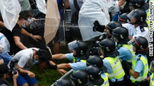 Riot police use pepper spray as they clash with protesters September 28, 2014.