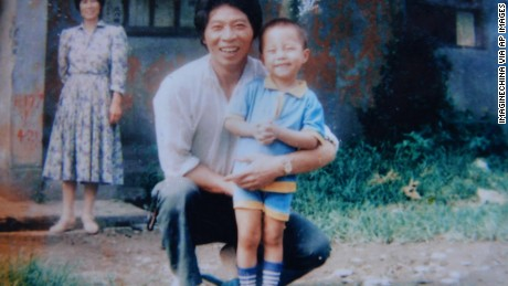 Sun Bin when he was four with his father.  Both are smiling for the camera.