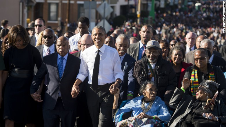 President Barack Obama held the hand of Amelia Boynton Robinson as they crossed the Edmund Petts Bridge 50 years after Bloody Sunday.