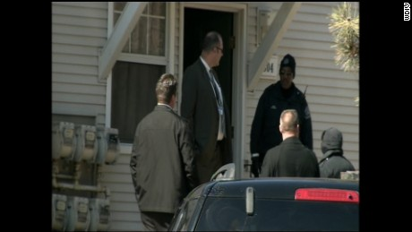 A baliff serving an eviction made the initial discovery of two bodies found in a freezer.