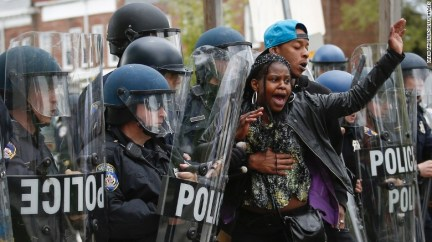 """Baltimore Police Department officers in riot gear push back protesters after the <a href=""""http://www.cnn.com/2015/04/27/us/gallery/freddie-gray-funeral/index.html"""">funeral of Freddie Gray</a> in Baltimore on Monday, April 27. Gray died on April 19 from a severe spinal cord injury that he allegedly suffered while in police custody a week earlier. His death has sparked ongoing protests in Baltimore and raised long-simmering tensions between police and residents there. Click through the gallery for more images:"""