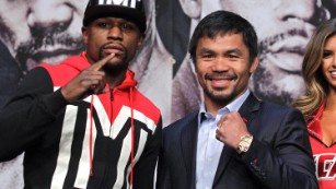 WBC/WBA welterweight champion Floyd Mayweather Jr. (L) and WBO welterweight champion Manny Pacquiao pose during a news conference at the KA Theatre at MGM Grand Hotel & Casino on April 29, 2015 in Las Vegas, Nevada. The two will face each other in a unification bout on May 2, 2015 in Las Vegas. AFP PHOTO / JOHN GURZINSKI (Photo credit should read JOHN GURZINSKI/AFP/Getty Images)
