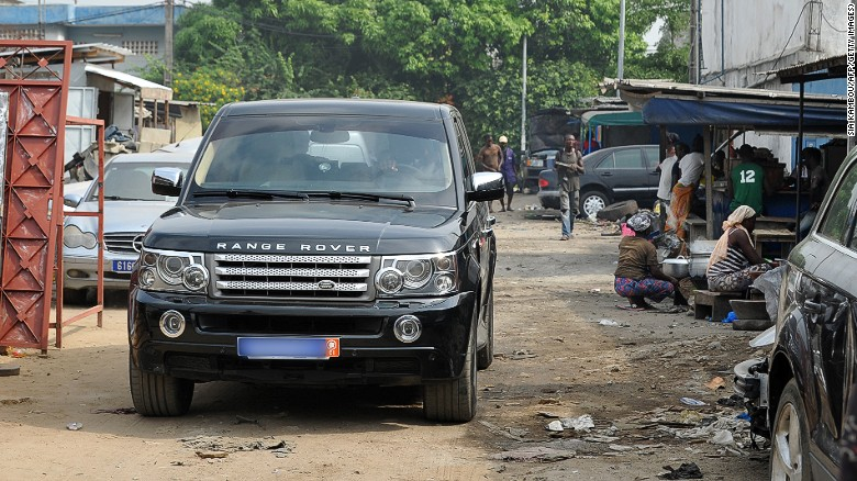 Range Rovers and other luxury cars are no strange sight in the streets of Abidjan, capital of Ivory Coast. Around 20% of the city's residents live in slums.