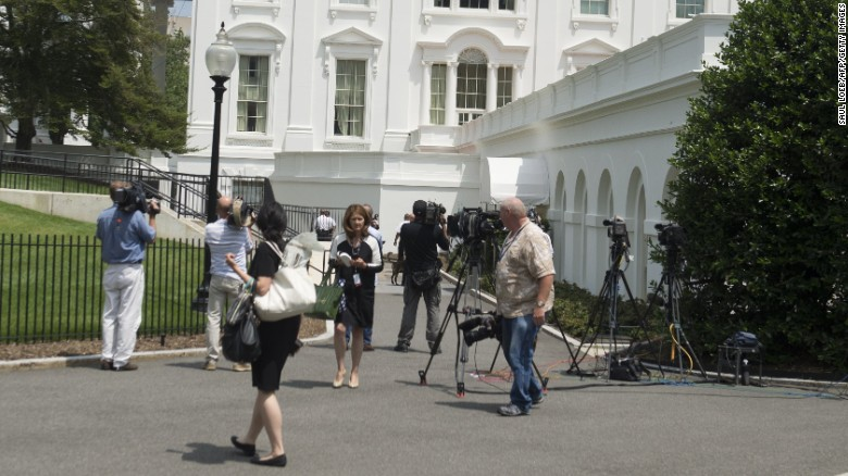 Members of the press evacuate from the Press Briefing Room at the White House following a bomb threat.