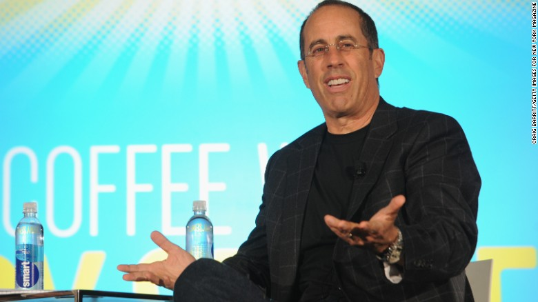 Jerry Seinfeld speaks on stage