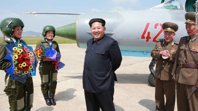 North Korean leader Kim Jong Un meets with North Korea's first female fighter jet pilots in this undated photo released by the country's state media on Monday, June 22. He called the women