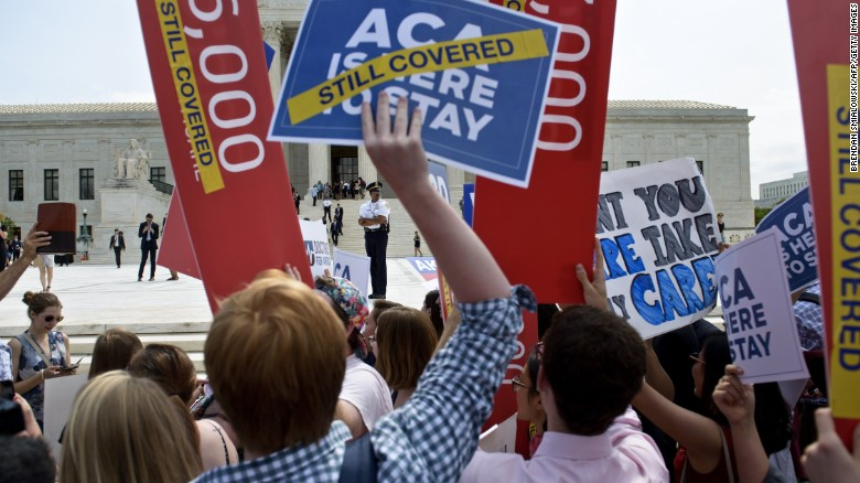 Supporters of the Affordable Care Act rally outside the U.S. Supreme Court.