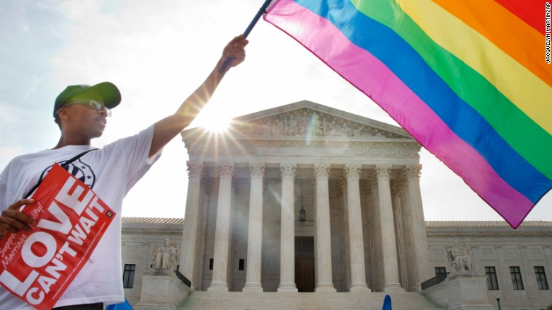 "Carlos McKnight of Washington waves a flag in support of same-sex marriage outside the U.S. Supreme Court on Friday, June 26. <a href=""http://www.cnn.com/2015/06/26/politics/supreme-court-same-sex-marriage-ruling/index.html"">The Supreme Court ruled 5-4</a> Friday that states cannot ban same-sex marriage, handing gay rights advocates their biggest victory yet. See photos from states that approved same-sex marriage before the nationwide ruling:"