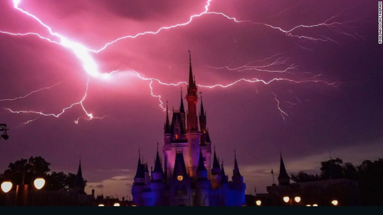 Onlookers caught the moment a lightning storm struck the castle at Disney World's Magic Kingdom.
