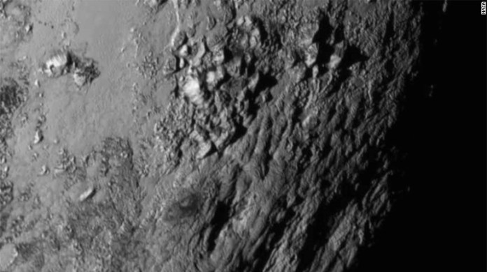 New close-up images of a region near Pluto's equator reveal a giant surprise: a range of youthful mountains. NASA released its latest series of Pluto images on Wednesday, July 15. Its New Horizons spacecraft was launched in 2006 and traveled 3 billion miles to the dwarf planet.