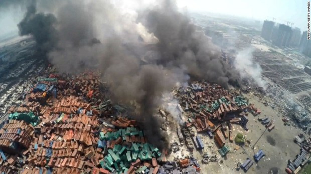An aerial image taken shows toxic smoke rising from debris in Tianjin, a sprawling port city of more than 13 million people about 70 miles from Beijing.