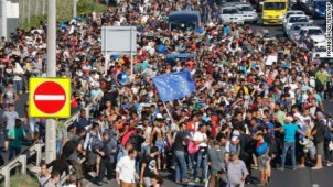 https://i0.wp.com/i2.cdn.turner.com/cnnnext/dam/assets/150904172147-migrants-walk-from-budapest-large-169.jpg?resize=302%2C170