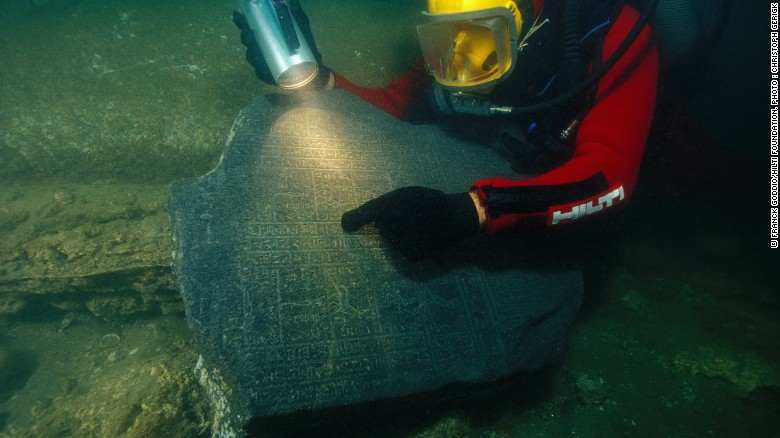 A diver inspects portions of a cella, a rectangular room found inside Greek temples, one of about 250 ancient Egyptian artifacts once thought to be lost to history, now on display in Paris.