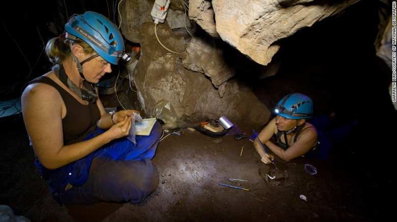 """Underground astronauts"" Marina Elliott and Becca Peixotto work inside the cave where fossils of Homo naledi were discovered."