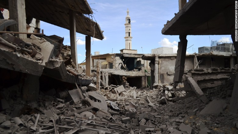 A minaret  towers over damaged buildings after airstrikes hit the central Syrian town of Talbiseh in Homs province Wednesday.