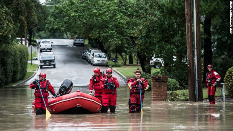 Rescue teams wait for an emergency vehicle in the Forest Acres neighborhood of Columbia, South Carolina, on Monday, October 5, 2015. South Carolina experienced record rainfall amounts over the weekend, forcing hundreds of evacuations and rescues.