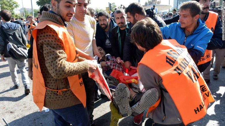 An injured person is caried away following a blast at a peace rally in Ankara on October 10, 2015.  At least 30 people were feared dead  in twin explosions in Turkey's capital Ankara, targeting activists gathering for a peace rally organised by leftist and pro-Kurdish groups.