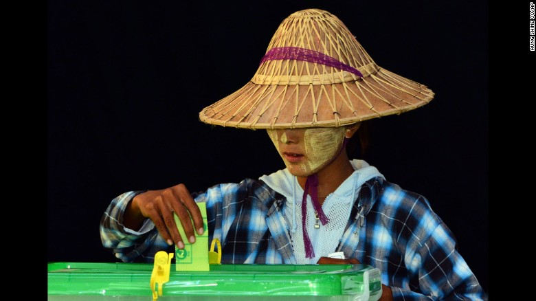 A woman casts her vote in a polling station in Naypyitaw, Myanmar, on November 8.