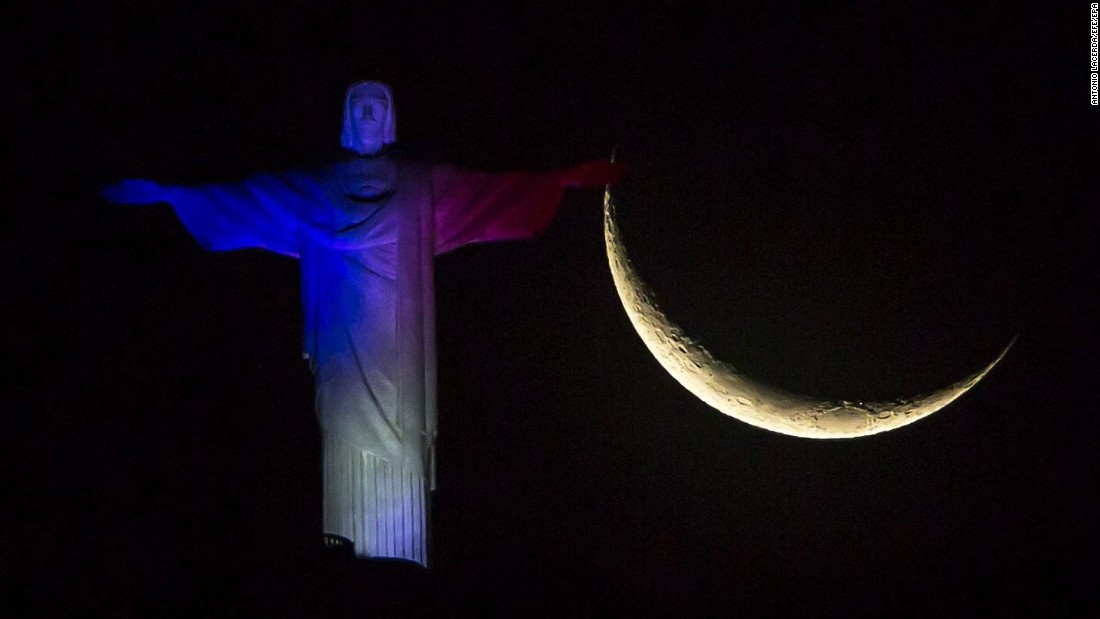 The Christ the Redeemer statue is illuminated in French national colors on Saturday, November 14, in Rio de Janeiro. Displays of support and solidarity for the French people were evident at landmarks around the globe.