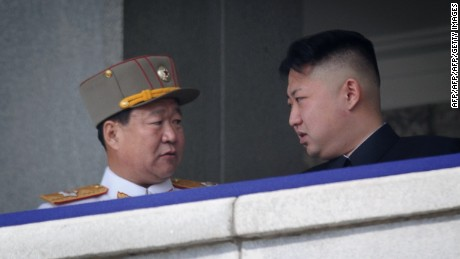 A photo taken on April 15, 2012 shows a man believed to be Choe Ryong-Hae (L) talking with Kim Jong Un.