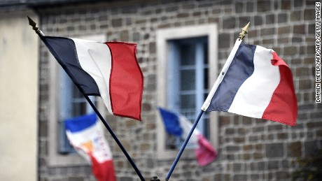 French national flags hang in the streets on Friday, November 27.