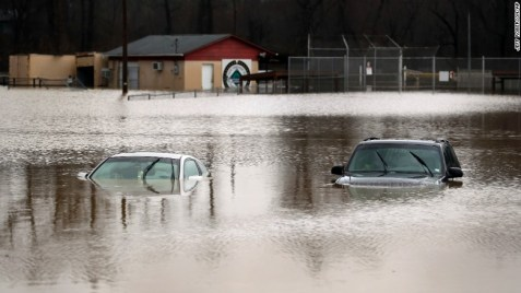 Cars are submerged in floodwaters in Kimmswick, Missouri, on December 28.
