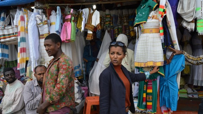 Abai Schulze haggles at Addis Ababa's large market for traditional Ethiopian clothes, Shiro Meda.