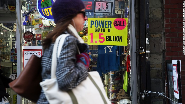 NEW YORK, NY - JANUARY 13:  A sign advertises the Powerball jackpoy outside of a magazine store on January 13, 2016 in New York City. After no winners were declared in recent drawings, Wednesday night's $1.5-billion jackpot is the biggest in lottery history. Powerball is played in 44 states and three U.S. territories.  (Photo by Spencer Platt/Getty Images)
