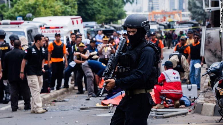 A policeman stands guard in front of a blast site in central Jakarta after a series of explosions rocked the heart of the Indonesian capital on January 14, 2016.