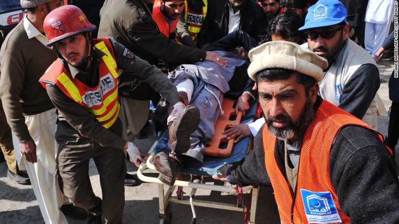 Pakistani rescuers shift an injured man to a hospital following an attack by gunmen in the Bacha Khan university in Charsadda, about 50 kilometres from Peshawar, on January 20, 2016. At least 21 people died in an armed assault on a university in Pakistan on January 20, where witnesses reported two large explosions as security forces moved in under dense fog to halt the bloodshed. AFP PHOTO /Hasham AHMED / AFP / HASHAM AHMED        (Photo credit should read HASHAM AHMED/AFP/Getty Images)