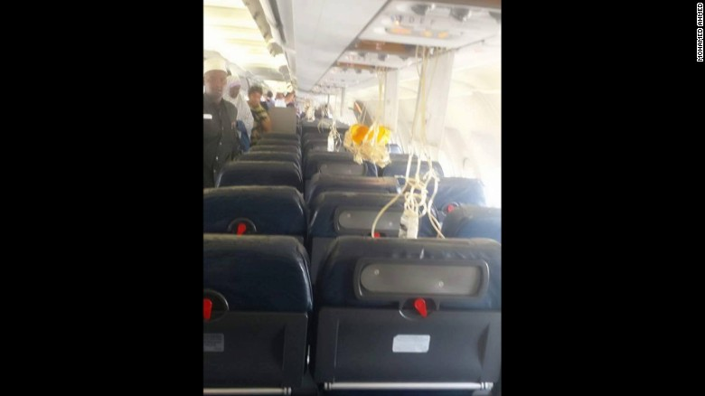 Oxygen masks dangle from the plane's ceiling after Tuesday's explosion.