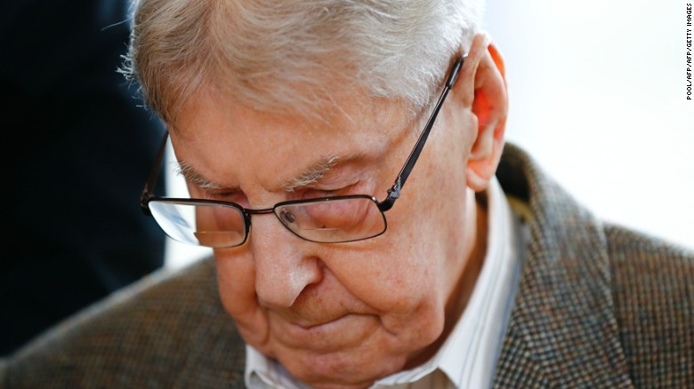 Former Auschwitz guard Reinhold Hanning, 94, arrives Thursday for his trial in Detmold, Germany.