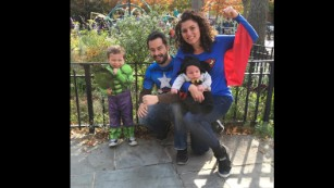 Raquel and Erwan Jegouzo pose as superheroes with their children.