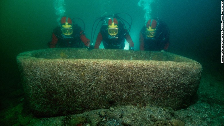 Goddio's team and a six-and-a-half-foot long pink granite garden vat dating from the fourth-to-second century BC. The ports became submerged through a variety of factors, including rising sea levels, subsidence, tidal waves and land liquefaction.