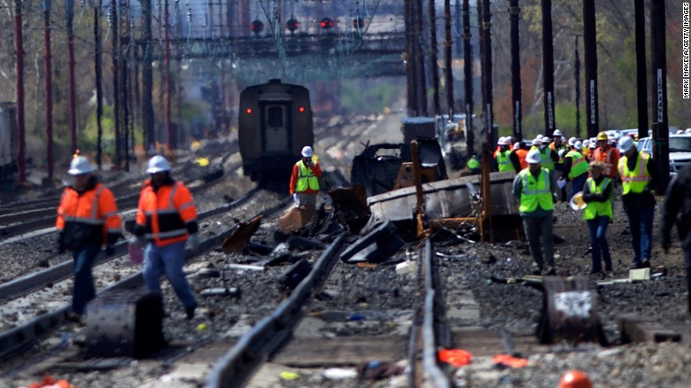 CHESTER, PA - APRIL 3:  Emergency personnel investigate the crash site of Amtrak Palmetto train 89 on April 3, 2016 in Chester, Pennsylvania.  Two people are confirmed dead after the lead engine of the train struck a backhoe that was on the track south of Philadelphia, according to published reports. Approximately 341 passengers and seven crew members were onboard the train, which was traveling from New York to Savannah, according to Amtrak.  (Photo by Mark Makela/Getty Images)