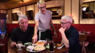 Bourdain, Cooper and 'sizzling, chopped-up pig face'