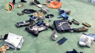 The debris includes passengers' belongings from the plane.