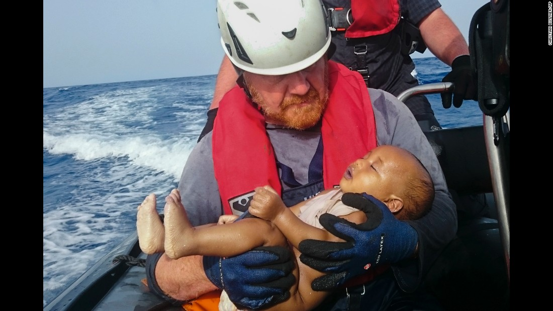 "A member of the humanitarian organization Sea-Watch holds a migrant baby who drowned after a boat capsized off the coast of Libya on Friday, May 27. The first five months of 2016 have been ""particularly deadly,"" according to the U.N. refugee agency, with at least 2,510 migrant deaths through May compared to 1,855 in the same period in 2015. <a href=""http://www.cnn.com/2015/09/03/world/gallery/europes-refugee-crisis/index.html"" target=""_blank"">Europe's migration crisis in 25 photos</a>"