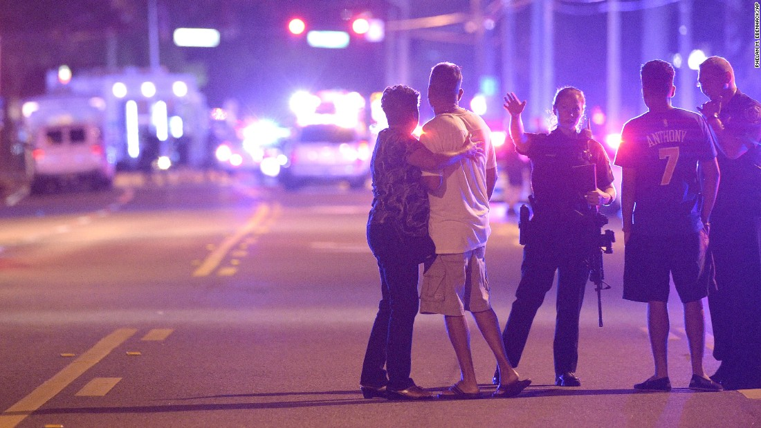 Police in Orlando direct family members away from the scene of the shooting.
