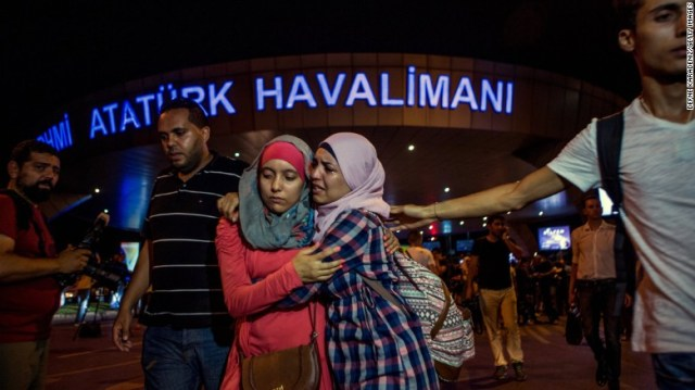 People flee the scene of a terror attack at Ataturk airport in Istanbul, Turkey, on Tuesday, June 28. Three terrorists armed with bombs and guns attacked the main international terminal, opening fire and eventually detonating their devices.