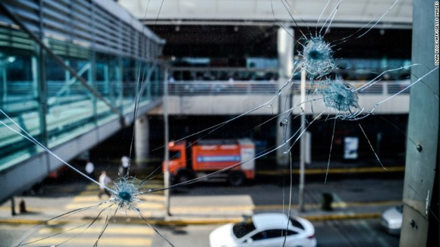 Bullet holes are seen in the windows at Ataturk International Airport on June 29.