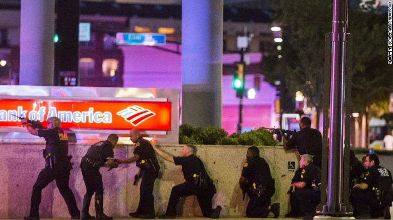 Dallas police respond after shots were fired during a protest in downtown Dallas, Texas, on Thursday, July 7. Snipers shot eleven officers, killing five. The otherwise peaceful rally was being held in response to the fatal shootings of two black men by police --  Alton Sterling on July 5, 2016 in Baton Rouge, Louisiana, and Philando Castile on July 6, 2016 in Falcon Heights, Minnesota.