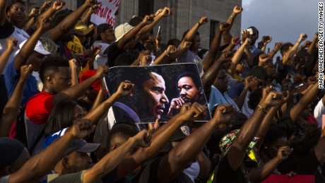 Demonstrators march at the Louisiana Capitol on Saturday to protest the shooting of Alton Sterling.
