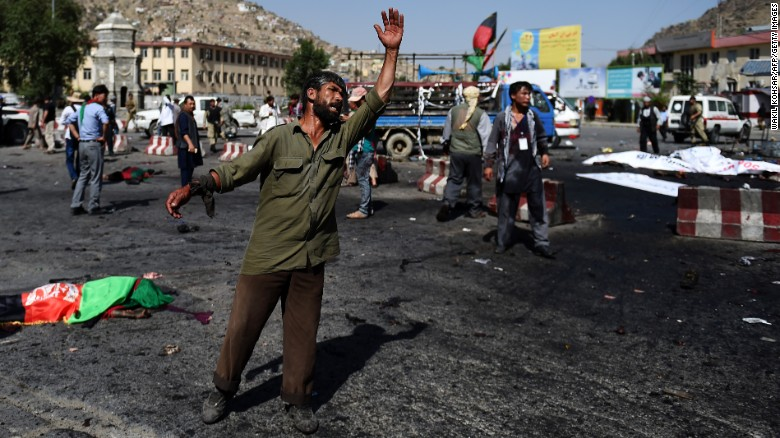 An Afghan protester screams near the scene of the suicide attack.