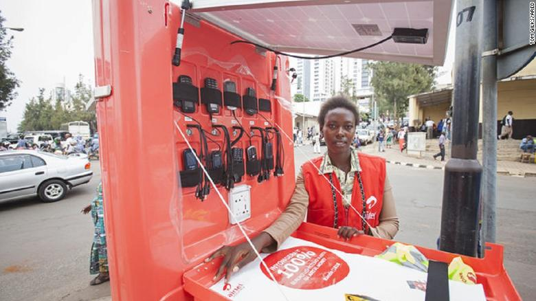 Solar kiosk franchisee, Jeanne Marie Uhiriwe, on the streets of Kigali, Rwanda