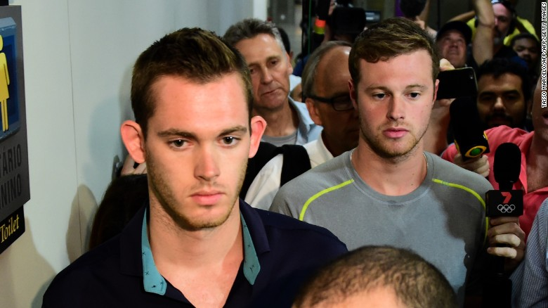 US swimmers Gunnar Bentz, left, and Jack Conger leave the police station at the Rio de Janeiro airport.