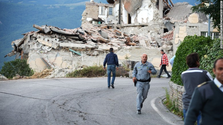Victims and rescuers walk among the rubble of houses after a strong heartquake hit Amatrice on August 24, 2016.  Central Italy was struck by a powerful, 6.2-magnitude earthquake in the early hours, which has killed at least three people and devastated dozens of mountain villages. Numerous buildings had collapsed in communities close to the epicenter of the quake near the town of Norcia in the region of Umbria, witnesses told Italian media, with an increase in the death toll highly likely. / AFP PHOTO / FILIPPO MONTEFORTEFILIPPO MONTEFORTE/AFP/Getty Images