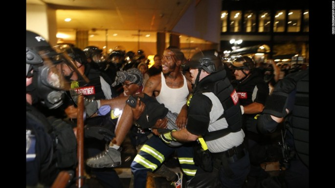 "Police officers and protesters carry a man who was shot <a href=""http://www.cnn.com/2016/09/21/us/charlotte-police-shooting/"" target=""_blank"">during a second night of protests</a> in Charlotte, North Carolina, on Wednesday, September 21. The shooting victim, 26-year-old Justin Carr, later died.  <a href=""http://www.cnn.com/2016/09/21/us/gallery/charlotte-protest/index.html"" target=""_blank"">Violent protests erupted in Charlotte</a> following the death of Keith Lamont Scott, who was shot by police in an apartment complex parking lot. Charlotte-Mecklenburg Police Chief Kerr Putney said Scott exited his car with a gun and that he was shot after he wouldn't drop it. Scott's family said he was unarmed and sitting in his car reading a book."