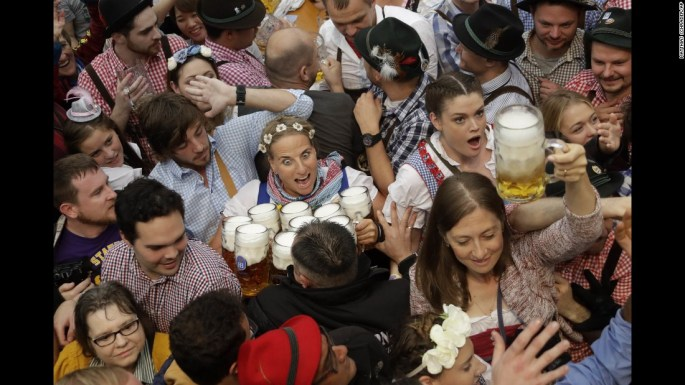 "A waitress holds beer glasses at the Oktoberfest opening in Munich, Germany, on Saturday, September 17. Oktoberfest is the world's largest beer festival. <a href=""http://www.cnn.com/2016/09/21/world/gallery/tbt-oktoberfest/index.html"" target=""_blank"">Check out these lighthearted Oktoberfest photos from the past century</a>"